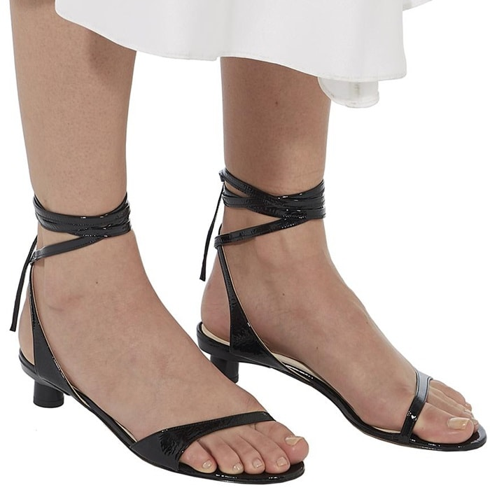 The little sandal that will take you from day to evening, this style is rendered in a patent black hue that creates a beautiful color story with a broad spectrum