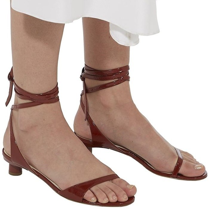 This crinkled patent sandal is rendered in an earthen rust hue that creates a beautiful color story with a broad spectrum.