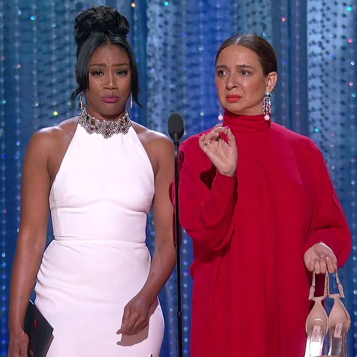 Tiffany Haddish and Maya Rudolph with their shoes off at the 2018 Oscars.