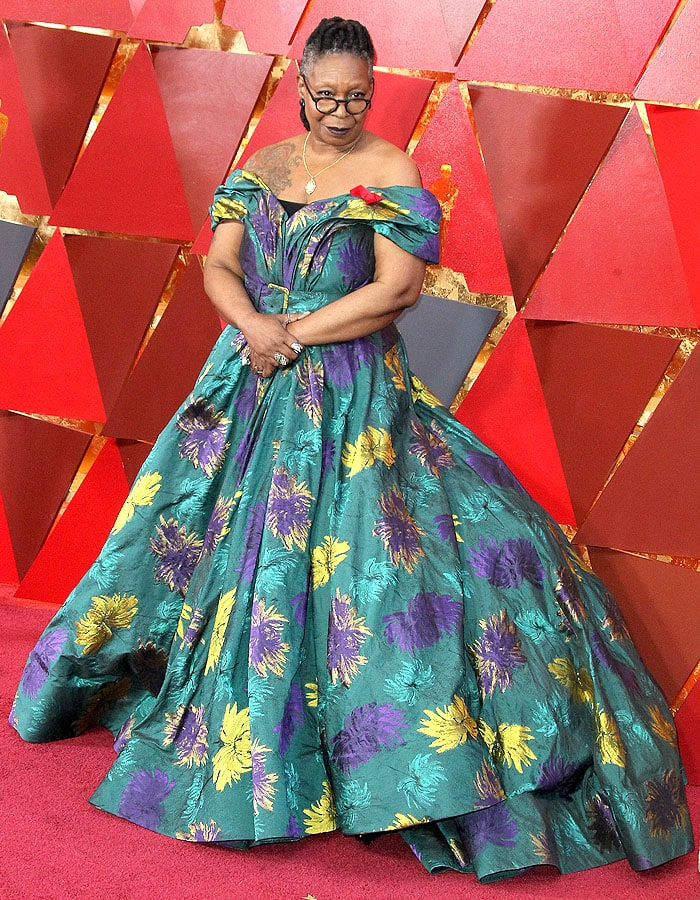 Whoopi Goldberg wearing a custom Christian Siriano ball gown with hiker boots.