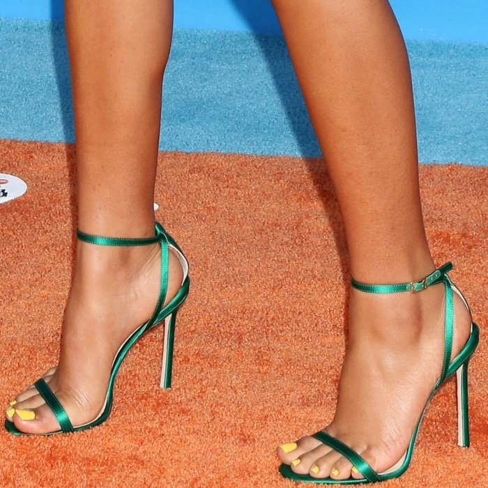 Yara Shahidi's feet in emerald green Jimmy Choo 'Minny' sandals