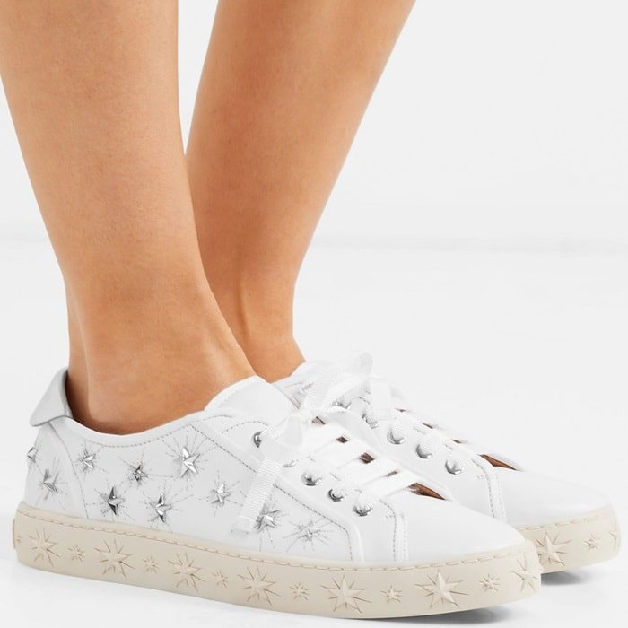 This low-top pair is made from smooth white leather and tipped with a high-shine tab at the heel which can be folded up or down