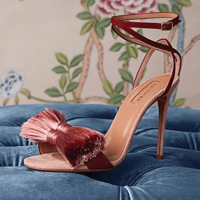 The burgundy-red suede front strap is adorned with a silken dusky-pink tassel bow