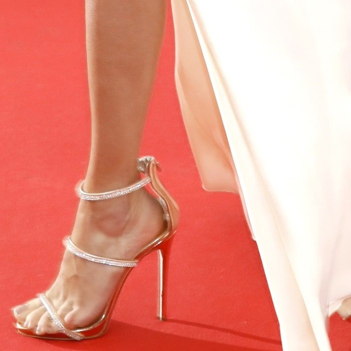 Adriana Lima showing off her feet in rose gold Harmony Sparkle crystal 3-strap sandals