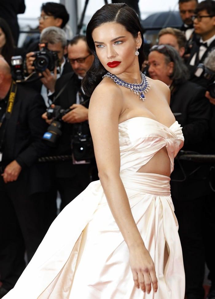 Adriana Limain a daring cutout Alberta Ferretti gown