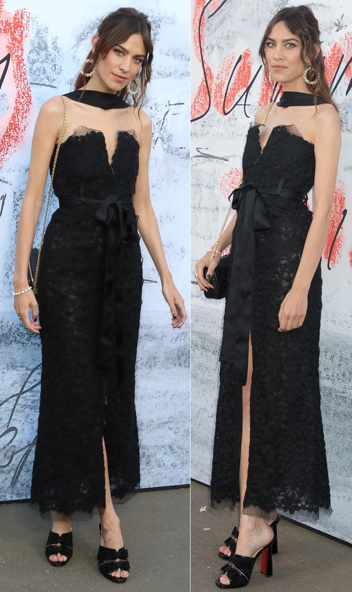Alexa Chung wearing a lacy Chanel Fall 2018 dress featuring a satin bow detail around the waist