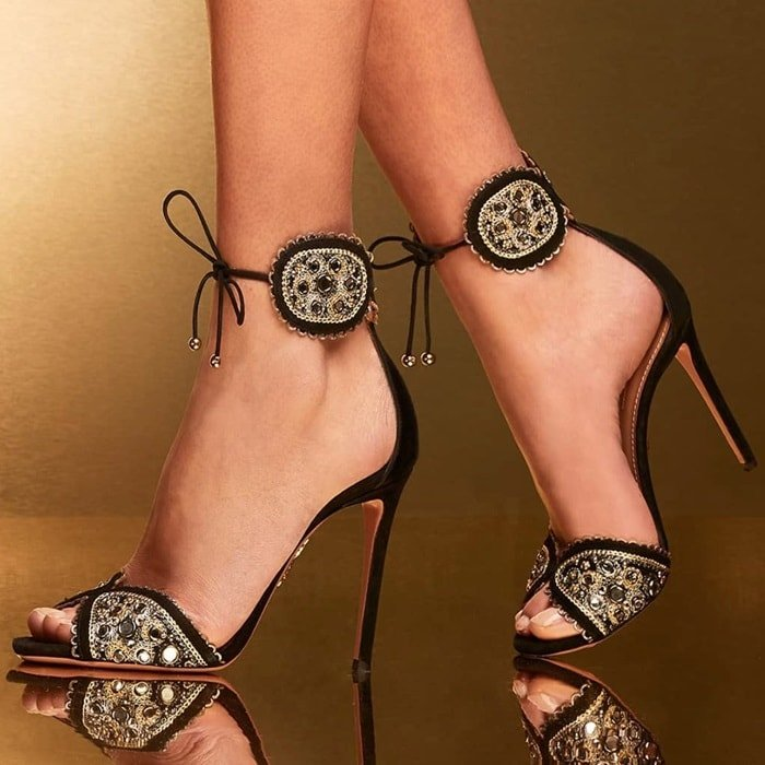 These 'Jaipur' sandals are made from black suede and decorated with mirror sequins, tiny studs and intricate embroidery
