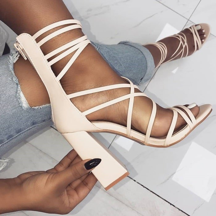 Nude 'Avery' heels featuring multi crossover straps, back zip and block heel