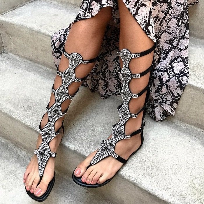 Black embellished mid-calf flat gladiator sandals with five adjustable buckles