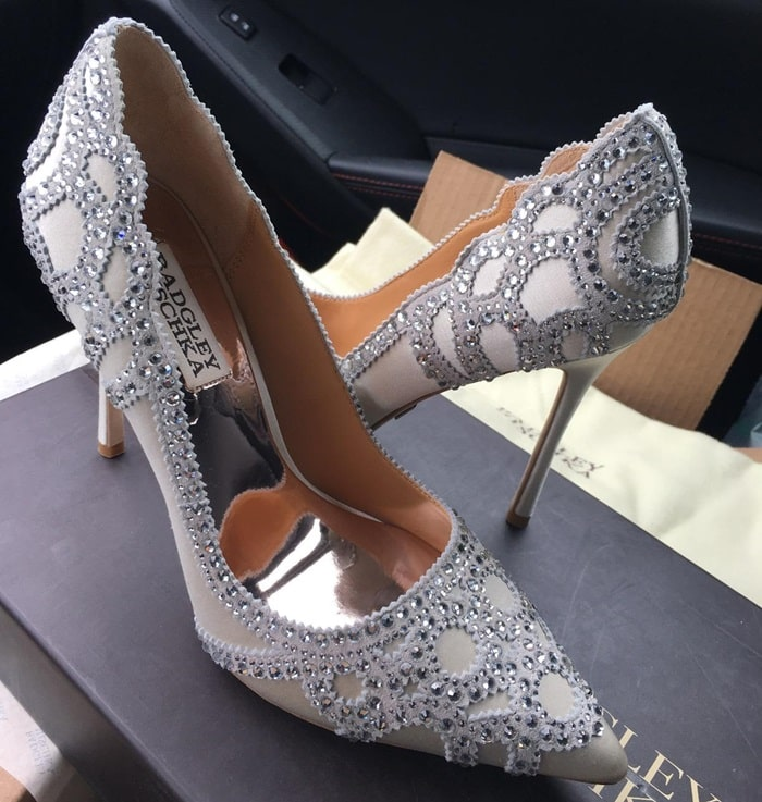 A scalloped pattern of glittering rhinestones accents these glamorous Badgley Mischka pumps