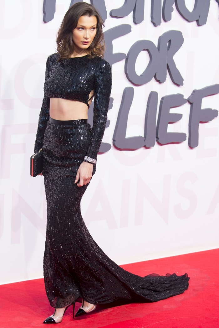 Bella Hadid in a sparkling black custom Julien Macdonald gown featuring a cutout at the midriff