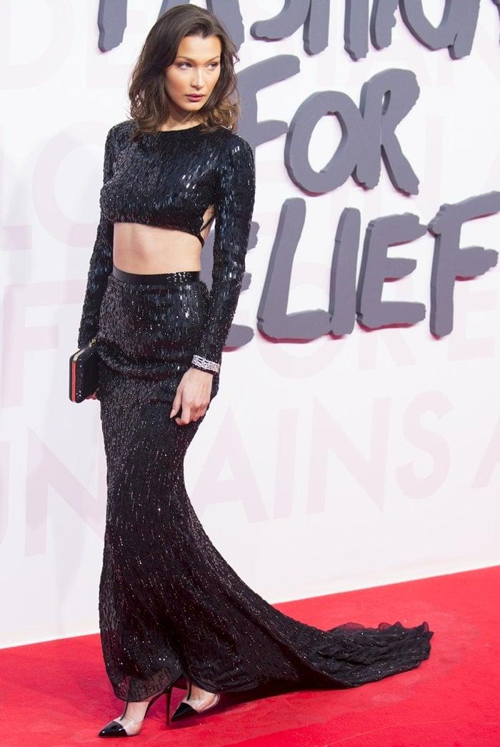 Bella Hadidina sparkling black customJulien Macdonald gown featuring a cutout at the midriff
