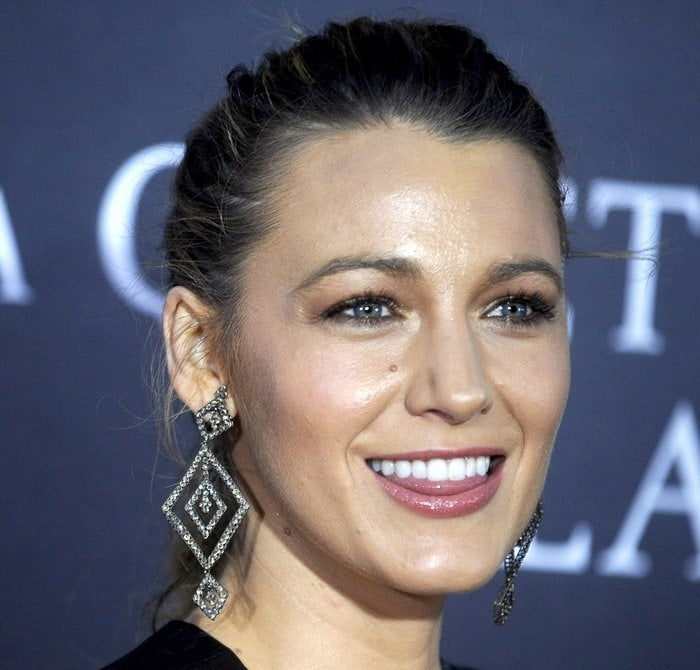 Blake Lively showing off her large Ofira pendant earrings