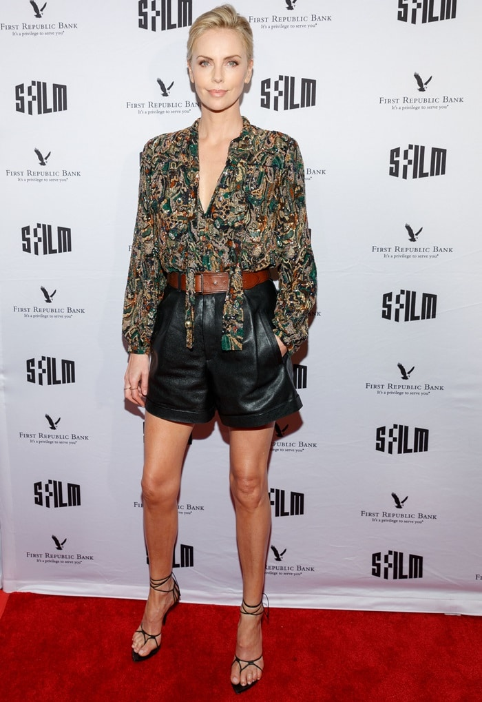 Charlize Theron'spleated shorts are composed of black grained lambskin