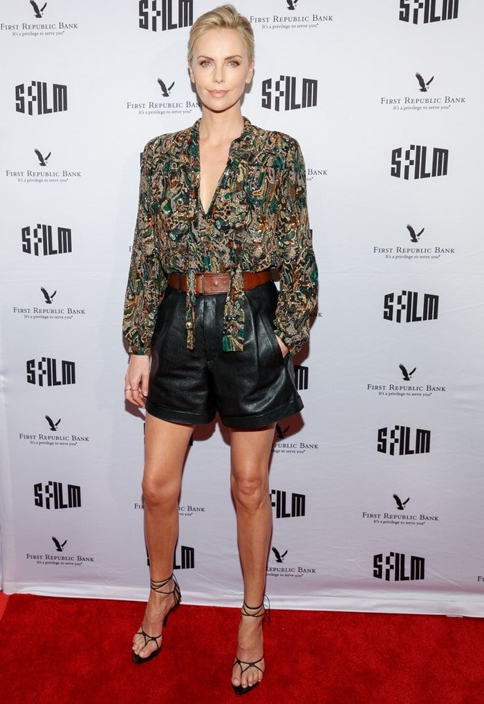 Charlize Theron's pleated shorts are composed of black grained lambskin