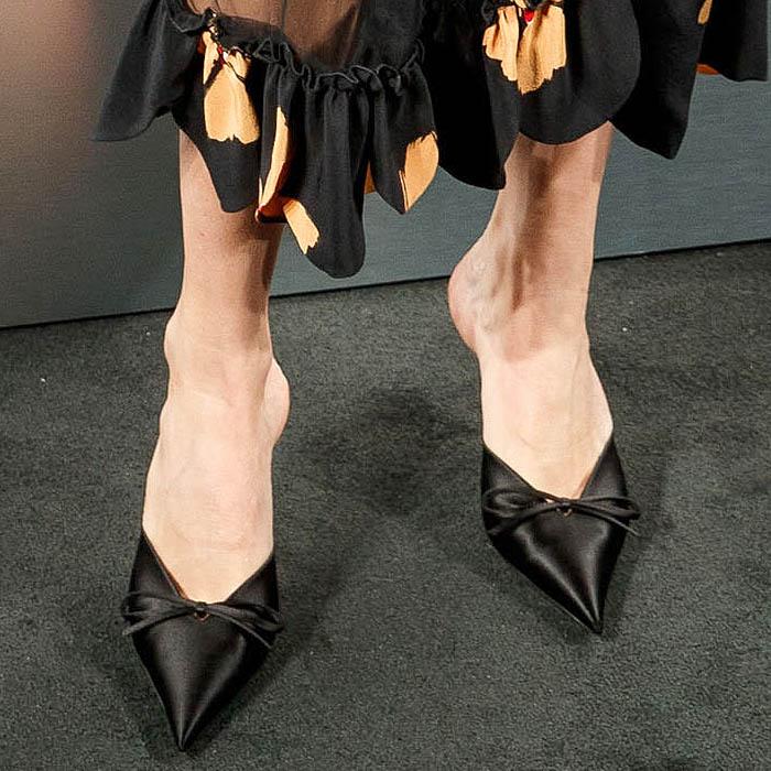 Closeup of Chloe Sevigny's Balenciaga Knife black-satin mules