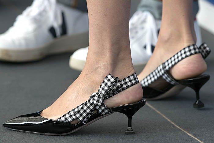 Details of the Miu Miu gingham-ribbon patent slingback pumps on Chloe Sevigny.