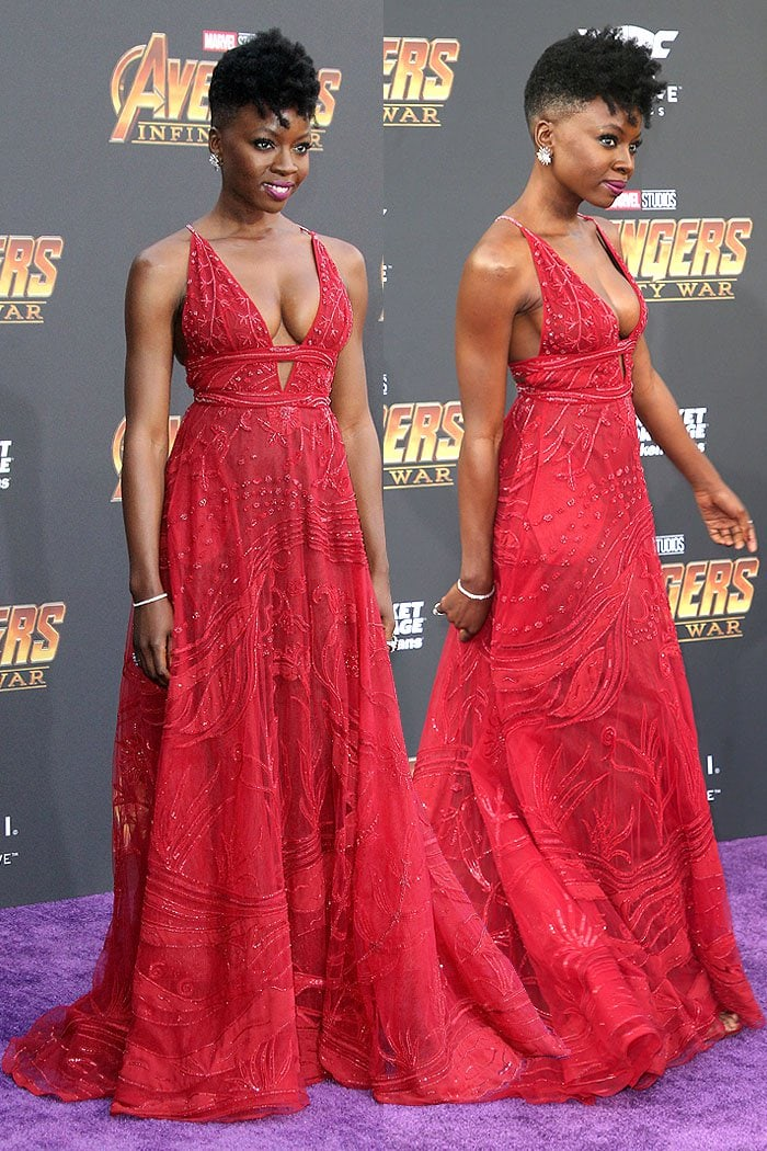 Danai Gurira in a Zuhair Murad Spring 2018 embellished red gown with matching glittery, red Jimmy Choo sandals.