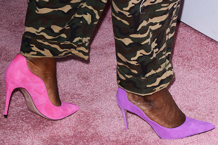 Details of Danielle Brooks' wavy-side, pink and purple suede pumps.