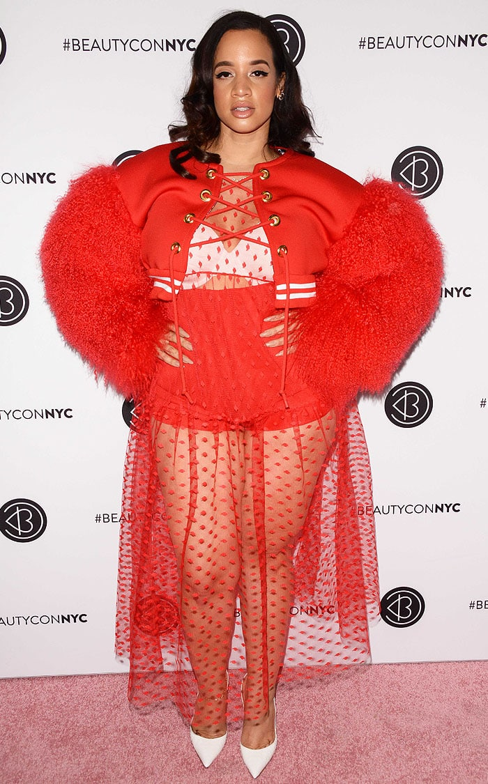 Dascha Polanco in a red outfit and white pumps at BeautyCon 2018.