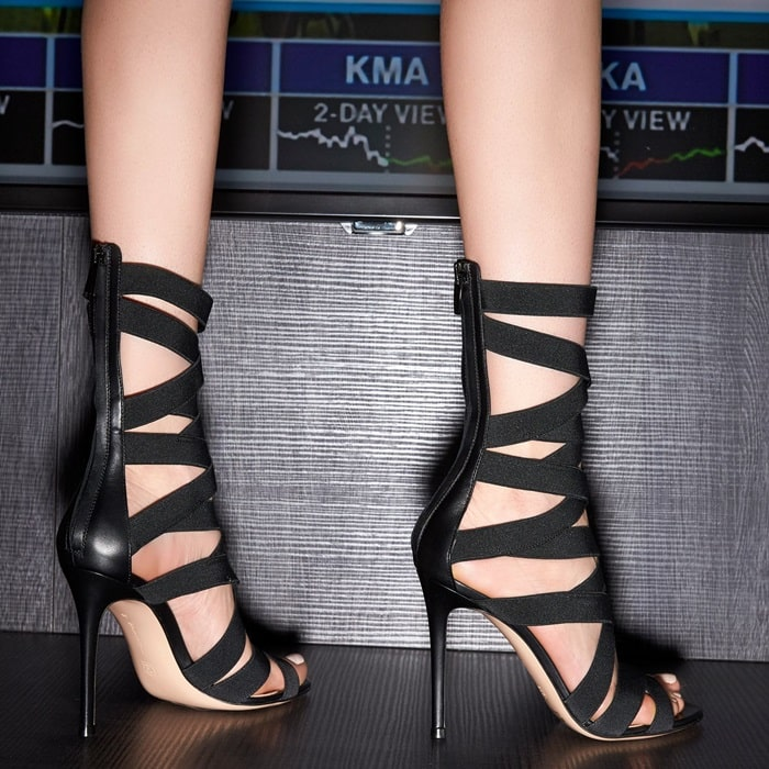 Representing the stretch mood of this season, the Elettra sandal wraps the foot up to mid calf with elastics all over