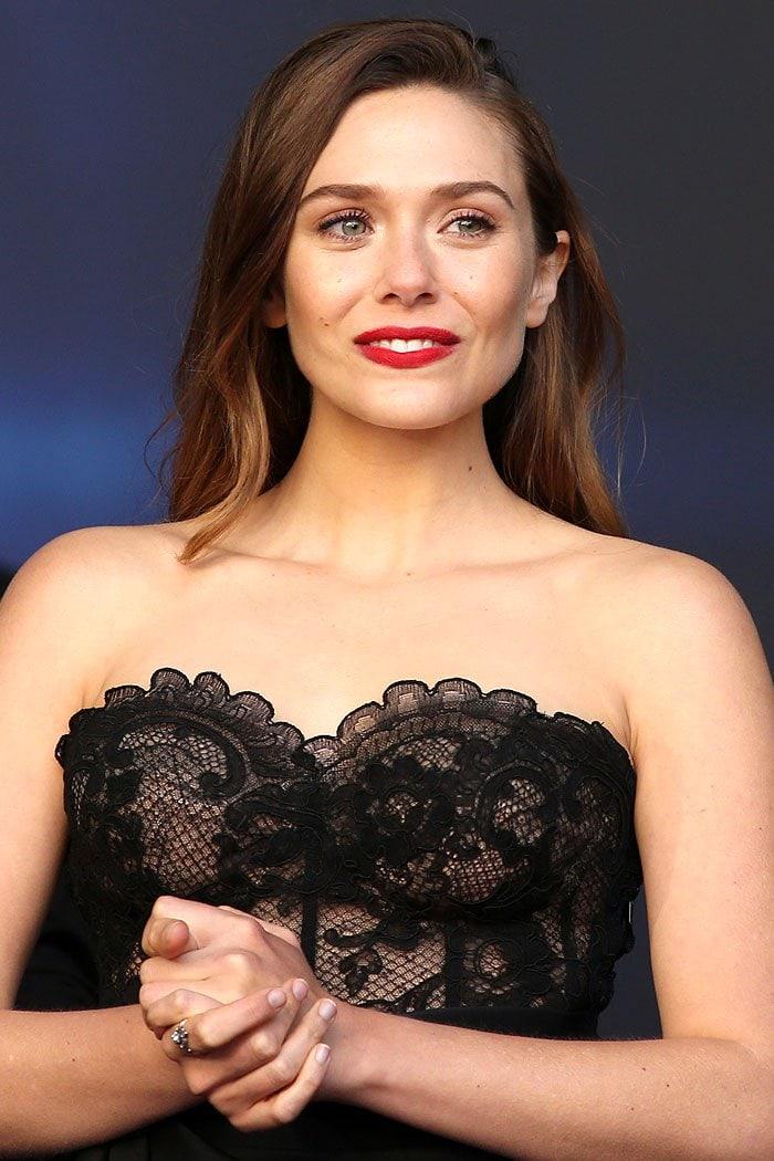Elizabeth Olsen in an Oscar de la Renta black lace bustier.