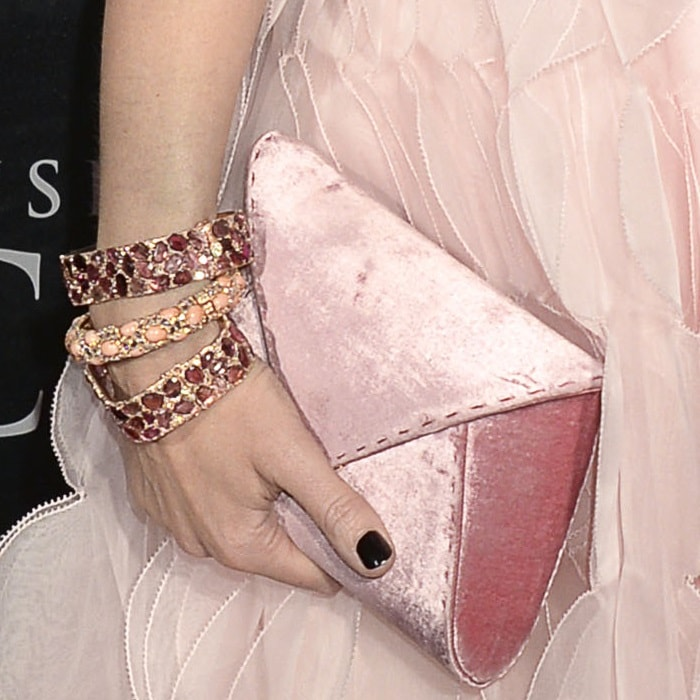 Emily Blunt's chunky bangles and pink velvet 'Lee Pouchet' clutch from Tyler Ellis