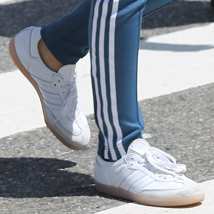 Closeup of Emily Ratajkowski's Adidas 'Samba' sneakers.