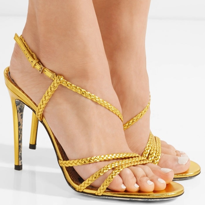 Crafted from gold leather, this pair is set on a 105mm stiletto heel and has slim braided straps that frame and flatter your foot