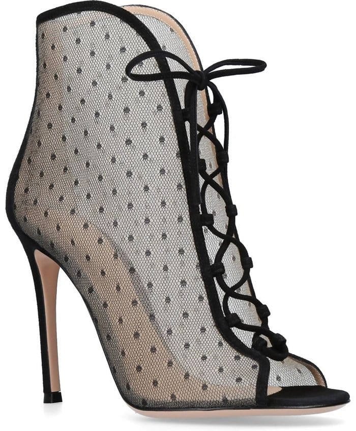 These black sexy dotted sheer Ivy booties from Gianvito Rossi feature an open toe, suede lace up panel and counter and stands on a 105 mm stiletto heel