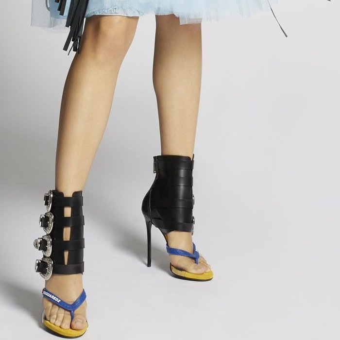 These sandals are accented with multiple western style buckles to the side
