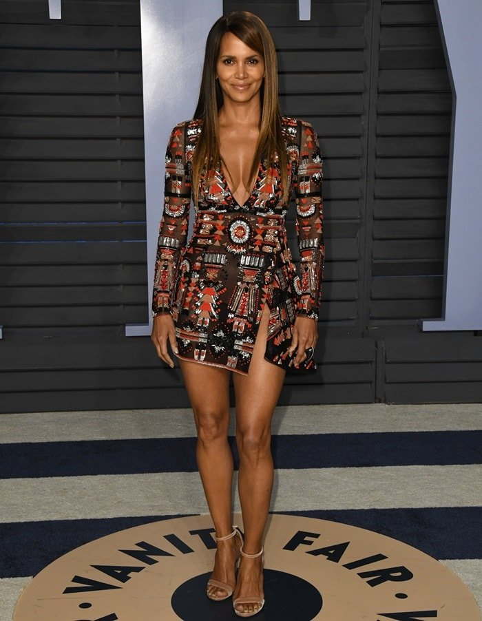 Halle Berry in a sheer embellished mini dress from Zuhair Murad's Spring 2018 Couture collection and nude Loriblu ankle strap sandals