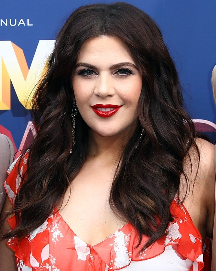 Hillary Scott'sthick brown hair resting on her bare shoulders