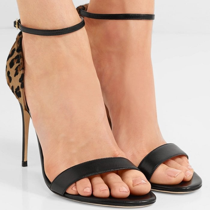 These sandals are crafted from black leather and trimmed with leopard-print calf hair