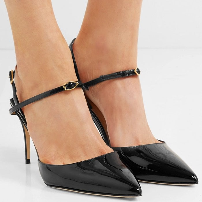 6c93cbb4ffb These black patent-leather  Vittorio  slingback pumps feature the label s  signature  eye.