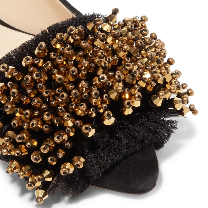 These pumps are decorated at the pointed toe with gilded beads
