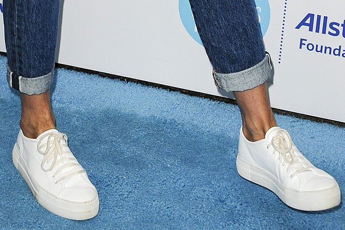 Closeup of Jennifer Aniston's Common Projects 'Tournament' leather sneakers.