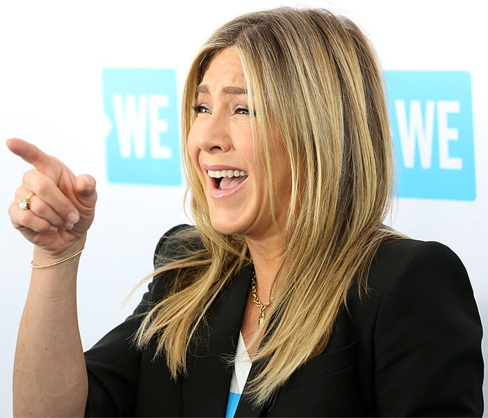 Jennifer Aniston wearing a Givenchy double-breasted blazer worn with the sleeves pushed up