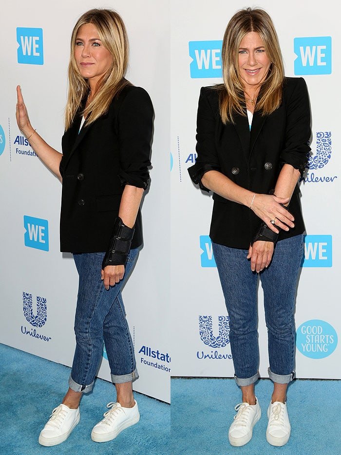 Jennifer Aniston looked to be in good spirits despite her hand injury