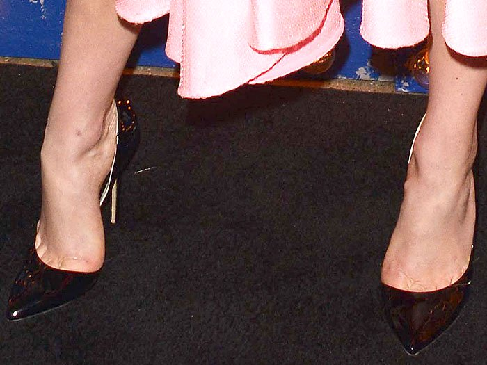 Closeup of the Brian Atwood Patty patent d'Orsay pumps on Karlie Kloss.