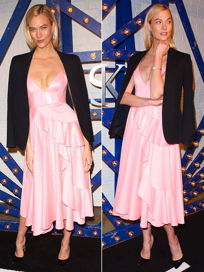 Karlie Kloss wearing a pink Alex Perry ruffled dress, a black Saint Laurent blazer, Brian Atwood 'Patty' pumps, and Swarovski 'Luminous Fairy' earrings.