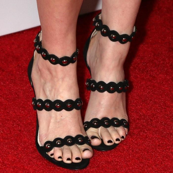 Kate Mara's black polished toes in studded Prada sandals