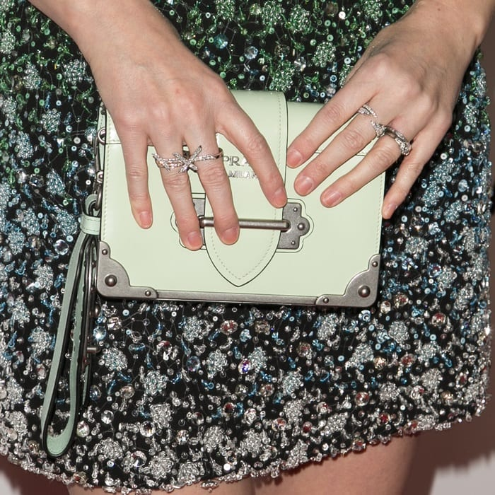 Kate Mara toting agreen and brown leather mini Cahier clutch bag
