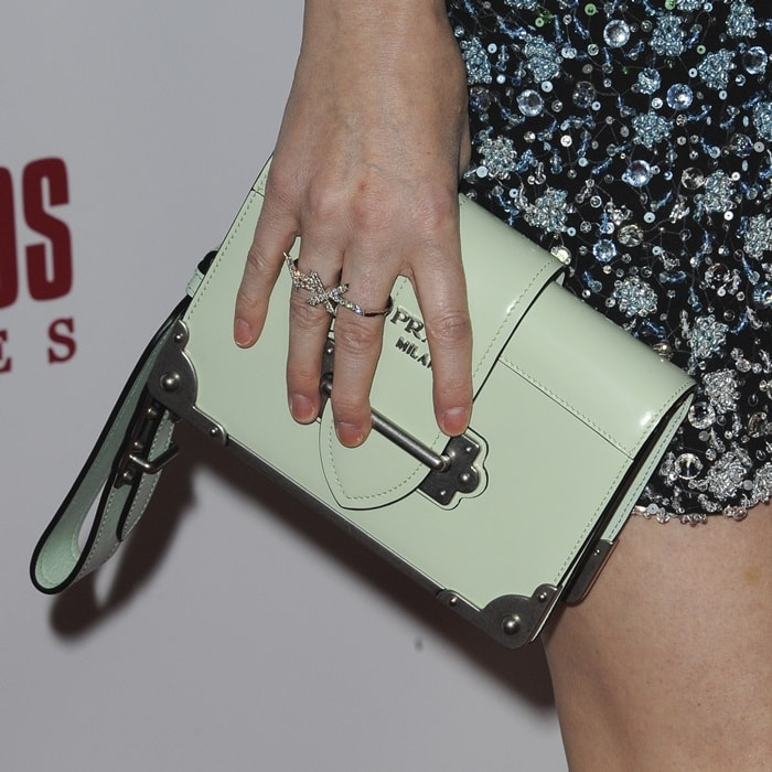 Kate Mara's structured polished leather clutch in aqua green