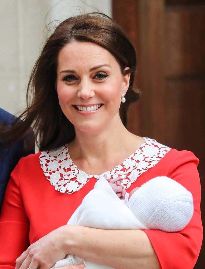 Catherine, Duchess of Cambridge (aka Kate Middleton) in a custom red dress by Jenny Packham featuring a white collar