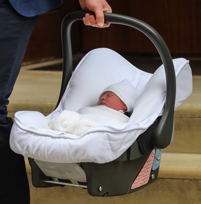 Prince William carrying his newborn son