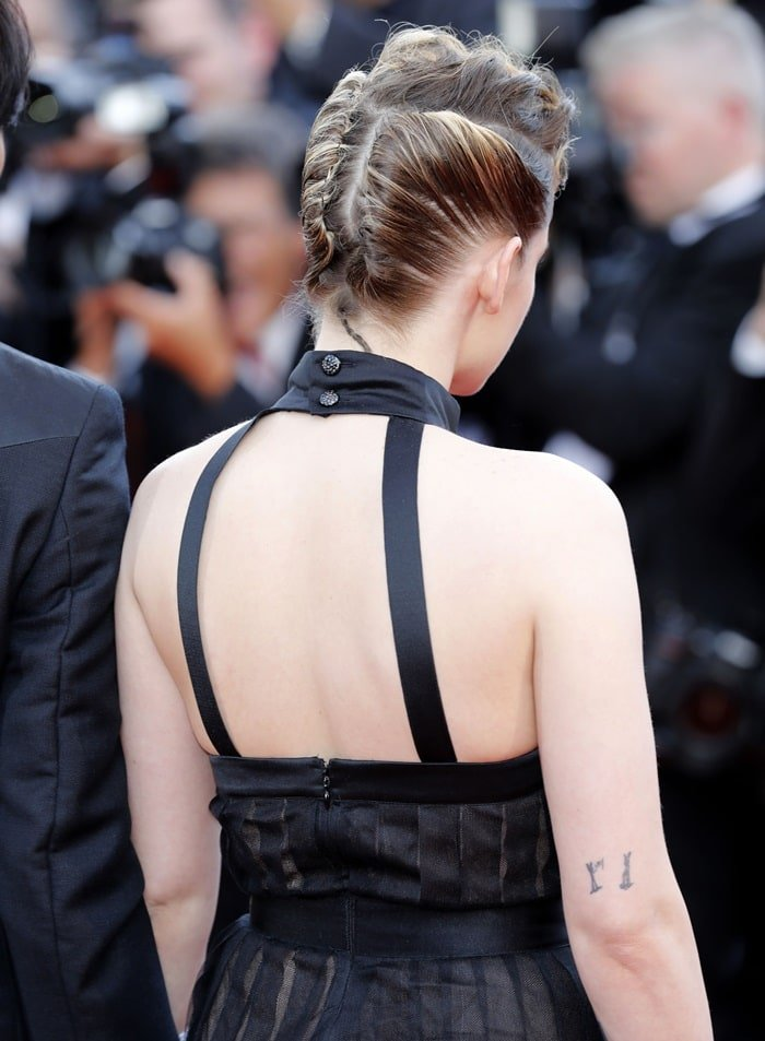 Kristen Stewart showing off the back of her classic LBD