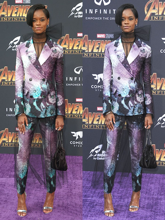 Letitia Wright in a custom Prada floral suit with silver layered-heel sandals and an embroidered satin handbag.