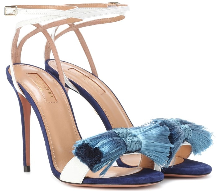A pair of luscious fringed bows adorn the foot and an adjustable buckled strap wraps gently around the ankle to secure a perfect fit