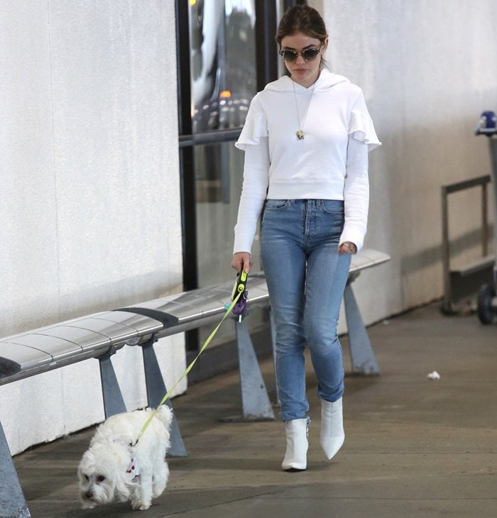 Lucy Hale's a white ruffle hoodie sweatshirt and high-rise straight-leg jeans